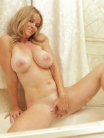 Totally Tabitha plays with her big boobs and bald pussy in the tub - Big Boobs, Shaved Pussy, Blonde, Long hair, Masturbation, Wet, Big Areolas, Tan Lines, Enhanced, Milf, Solo