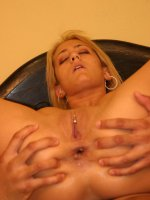 Blonde babe Trina Michaels playing with her big tits while bouncing on top of a stiff cock