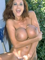 Huge Titties on Brown Haired Babe Playing Outside