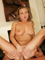 Buxom pornstar Rita Faltoyano gets her pussy stuffed and her big boobs glazed with cum