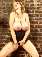 Blonde Posing with Perfect Pair of Mammoth Breasts