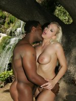 Interracial live show with Nikki Hunter making a black dick disappear into her cunt