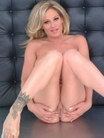 tattooed blonde hottie with melo jugs exposing sexy body