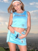 Busty cheerleader Tiana hikes up her top to unleash her big breasts while rubbing her gash