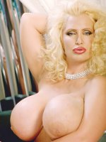 Curly Haired Blonde with Huge Breasts Posing