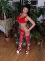 Dark-haired breasty vixen in red lingerie showing off her tools