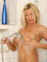 Long haired blonde milf spends extra time cleaning her juicy pink milf pussy - Big Boobs, Landing Strip Pussy, Blonde, Long hair, Wet, Tan, Thongs, Mini Skirt, Enhanced, Milf