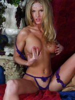 Blonde vixen taking off her bikinis to unleash her huge well rounded bazooms live