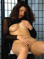 Chubby brunette bitch displaying her huge hooters in her see through black blouse