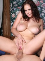 Smoking hot redhead Gianna does a striptease to unleash her big natural knockers and ride a big cock