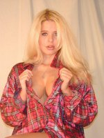 Sassy blonde model unbuttoning her flannel to show off her ample set of big tits live