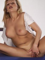 Sexy blonde naked from the waist down showing off her big boobs and wet muff live