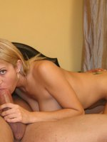 Pretty blonde porn babe Trina Michaels playing with her big tits while gulping down a big cock